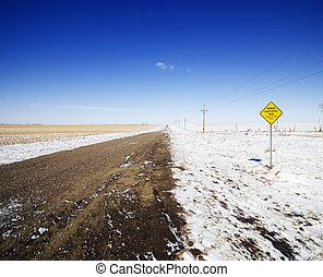 Dirt winter road.