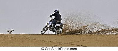 Dirtbike off roading in sand dune