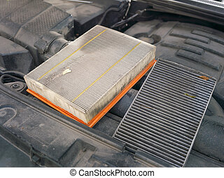 Dirty Air Car Filters - Dirty used car air filters placed on...