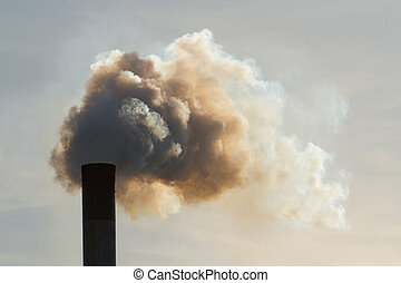 dirty air - Fumes belch out of the top of an industrial...