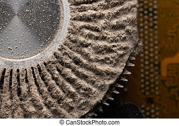 Dirty aluminum heatsink for cooling the central processing unit of a personal computer. Lumps of dust and dirt on the cooling element. Cause of electronics failure
