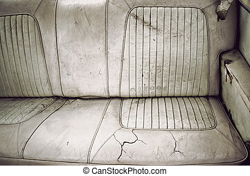 Dirty back seat - Dirty broken leather back seat of vintage...