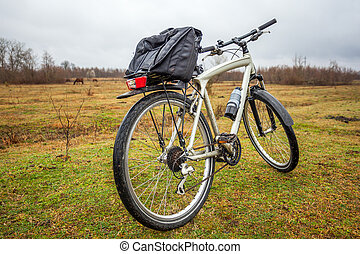 dirty bike on the field in cloudy time