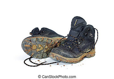 A pair of dirty hiking boots isolated in white background