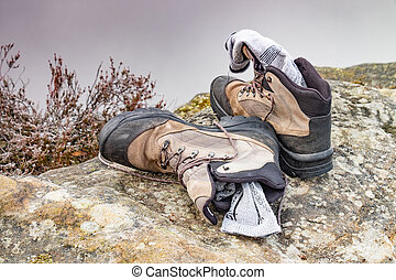 Dirty boots for hiking on stones in the forest after a hike
