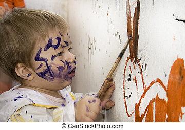 Dirty little boy sketching paintbrush.