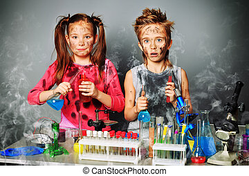 dirty children - Two children making science experiments. ...