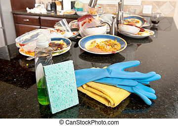 Kitchen and dish washing cleaning supplies ready to be used on dirty, filthy dishware.
