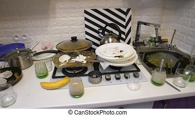 Dirty dishes on the kitchen - Huge heap of dirty dishes