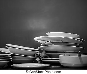 Dirty dishes stacked after lunch