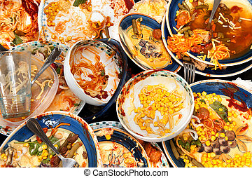 Dirty dishes - A mass of dirty, filthy dishes with food...