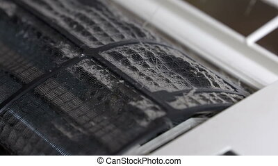 Dirty dust filters of split air conditioner closeup