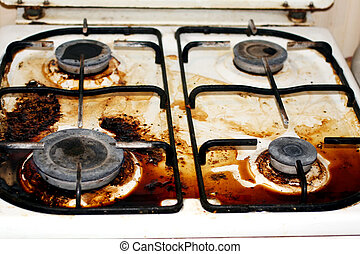 Dirty gas stove. Fat, rust on the surface.