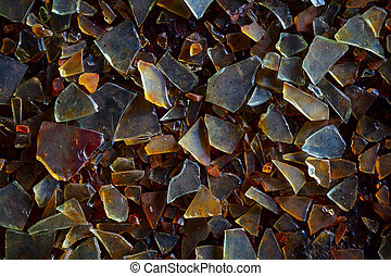 Old dirty glass shards on the ground - industrial waste grunge background