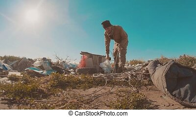 dirty homeless man at the dump slow lifestyle motion video....