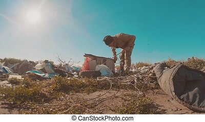 dirty homeless man at the dump slow motion lifestyle video....