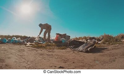 dirty homeless man at the dump slow motion video. homeless...