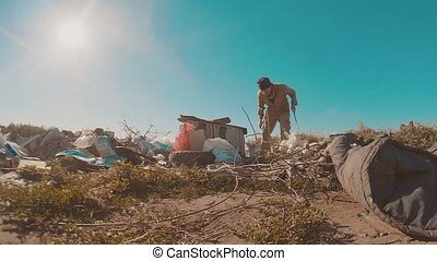 dirty homeless man at the dump slow motion video. lifestyle...