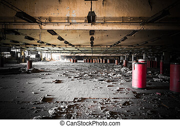 dirty industrial interior of an abandoned factory building