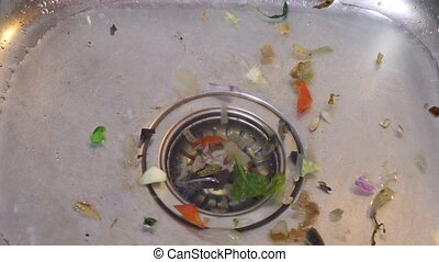 Dirty Kichen Sink - Kitchen drain clogging up with food...