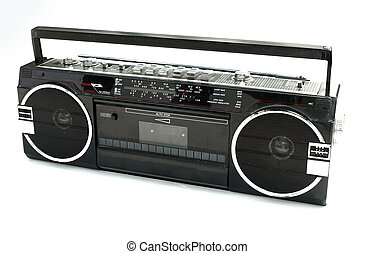 Dirty old 1980s style cassette player radio against a white background