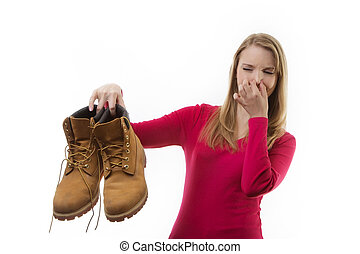 Dirty Smelly shoes - woman holding up men's smelly work boot...
