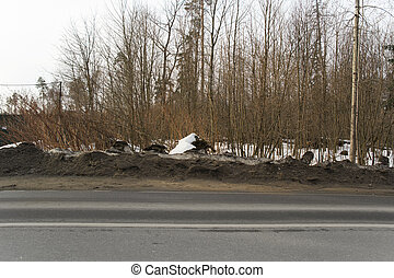 dirty snow on the roadside