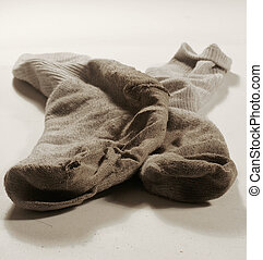 Dirty socks 2 - A pair of dirty white socks with holes in...