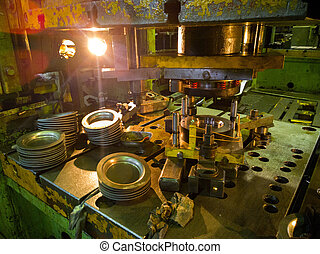 dirty used low tech stamping press producing round aliminium parts