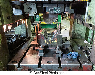 dirty used low tech stamping press with sheet metal die tooling