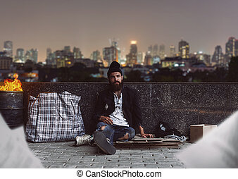 Dirty vagrant - Dirty homeless sitting on the cardboard with...