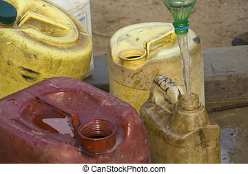 Dirty water jugs being filled in Africa - Dirty water jugs...