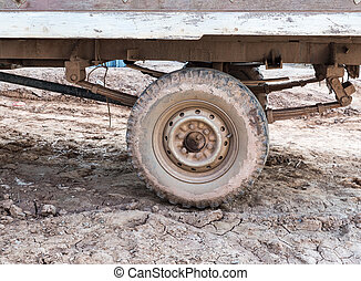 Dirty wheel of the local small truck.