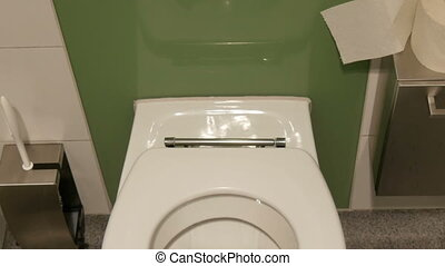 Dirty white ceramic toilet in the public toilet cubicle. -...