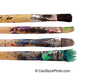 Dirty wooden paint brushes isolated on white background. Art...