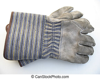 Dirty work gloves on a white background