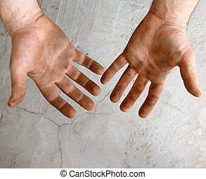 Dirty work - male dirty hands over gray concrete background