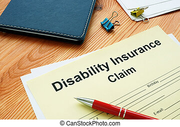 Disability Insurance Claim for filling in and pen.