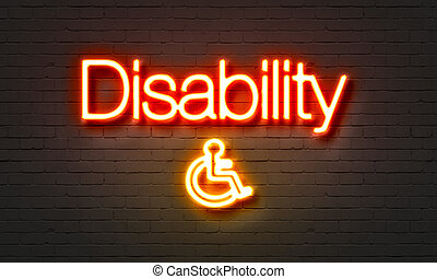 Disability neon sign on brick wall background.
