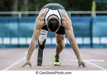 Disabled athlete preparing to start running. position of...
