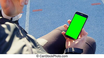 Low section of disabled athletic using mobile phone at sports venue 4k