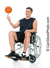 Disabled Basketball Player Spinning Ball