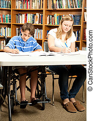 Disabled Boy Doing Homework - Disabled boy and a friend...