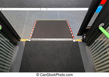 Disabled bus ramp - Retractable ramp for wheelchair at city ...