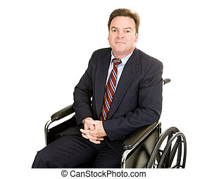 Disabled businessman in wheelchair with a serious, dignified expression. Isolated on white.