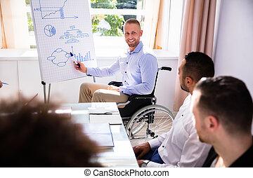 Disabled Businessman Giving Presentation