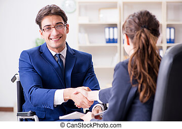 Disabled businessman having discussion with female colleague