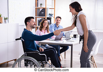 Disabled Businessman Shaking Hand With His Colleague