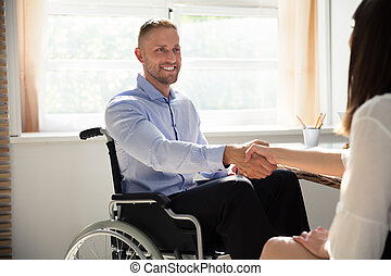 Disabled Businessman Shaking Hand With His Partner