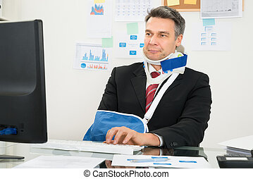 Disabled Businessman Using Computer - Portrait Of Disabled...